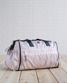 We like gear that works and plays as hard as we do. With strategically placed pockets for our laptop, yoga mat and water bottle, plus wet/dry compartments for our bikini, dirty shoes and sweaty gear, this duffel bag fits the bill.