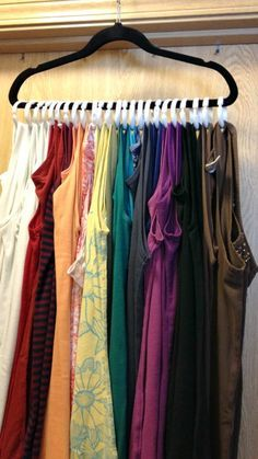 Clever Tank Top Hanger ~ Use shower curtain rings  to hang up your tank tops and free up space in your dresser drawers!