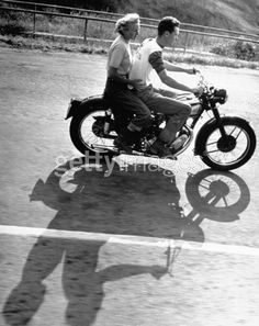Riders enjoying motorcycle riding double. (Photo by Loomis Dean//Time Life Pictures/Getty Images)1 Jun 1949