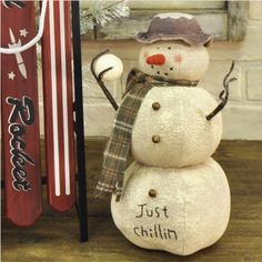 "Liven up the indoors when it's still a winter wonderland outdoors! This Just Chillin' Snowman brings warm winter greetings to add to your winter decor. Soft sculped body with worn off paint is accented with rusted bells, wool scarf and hat. 12"" high x 6"" diameter. #christmas #snowman"