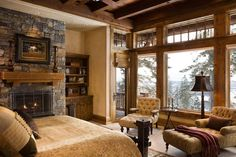 Master Bedroom: love the fireplace, lounge chairs, windows. Less yellow, more ivory.