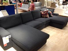 Kivik sofa with two chaises in Dansbo Dark Gray. The arm can come off so you can install another chaise. A Kivik sofa that is just made up of chaises would be cool in a basement movie room!