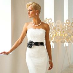 Strapless lace sheath with black lace belt.