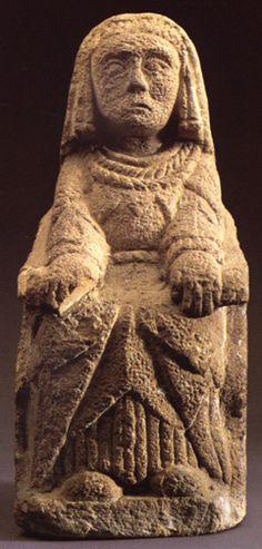 Seated woman with offerings in both hands. Cerro de los Santos, Albacete.