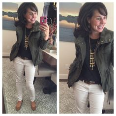 military jacket, white jeans, and gold jewelry