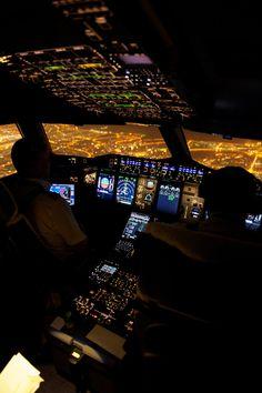 Captain and Senior First Officer on Board A.380 Flight Deck. (Night Flight.)
