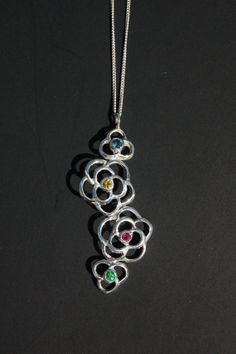 Items similar to Sterling Silver rose pendant with genuine blue sapphire, yellow sapphire, ruby and tsavorite garnet. on Etsy Pendant Design, Silver Roses, Pendants, Necklaces, Pendant Necklace, Sterling Silver, Unique Jewelry, Handmade Gifts, Blue