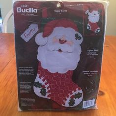 """New in sealed package Bucilla felt and cross stitch stocking titled Happy Santa. Completed project will be 18"""" once you have finished creating your masterpiece. Bin 2 