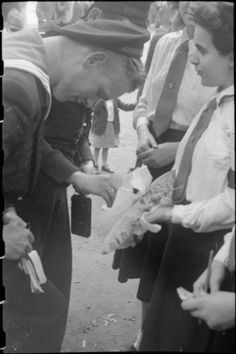 War Fair: Holidays at Home at a fete in Russell Square, London, 1943. A Dutch sailor stops to buy a raffle ticket from a member of the Red Cross cadets at the Russell Square fete. The prize is a model battleship. #wartime #WW2 #history