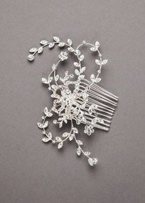 This stunning crystal comb offers a sleek look. It is embellished with a casted crystal floral and vine embellishment. Features vine design adorned with crystals. Available in silver.