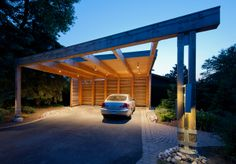 """It's the best carport in town"", said one of the judges in a recent carport competition. The carport's design incorporates panels that slide out along the side to stop the winds and snow in winter, but can be moved out of the way in summer. Carport Sheds, Carport Plans, Carport Garage, Pergola Carport, Carport Canopy, Custom Home Designs, Custom Homes, Garages, Modern Carport"