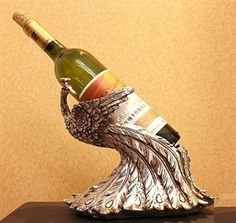 peacock wine bottle holder...I have to have this. It combines two of my favorite things!