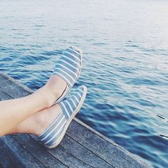 Best seat in the house: #regram @feiffers taking in the view, wearing Soludos classic stripe espadrilles in light navy and white #soludos #soludossummer