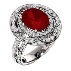 Stuller. Style 122003:652:P, 14k white engagement ring mounting shown set with 11.00mm x 9.00mm imitation ruby center and diamond accents, $2,815, Stuller