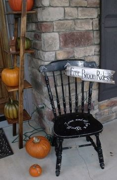 Come and sit a spell chair with Free Broom Rides sign.
