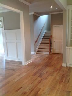 View of downstairs hall and stairway - 5 inch onsite finished hardwoods