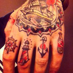 Ship wheel lighthouse anchor finger tattoo