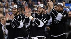 LOS ANGELES, CA - JUNE 13: Anze Kopitar #11 and Kyle Clifford #13 of the Los Angeles Kings cheeer after the Kings defeat the New York Rangers 3-2 in double overtime during Game Five of the 2014 Stanley Cup Final at Staples Center on June 13, 2014 in Los Angeles, California.