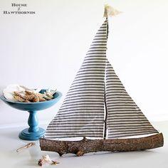 Adorable DIY sailboat.  See full tutorial here.