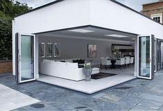 Corner Bi-Fold Doors- Exclusively Designed By Origin Wide open corner doors looking into a contemporary open plan living area Corner Bifold Doors, Corner Door, Bifold Doors Onto Patio, Sliding Doors, House Extension Plans, House Extension Design, Extension Ideas, Garden Room Extensions, House Extensions