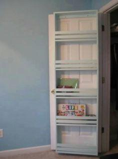 Back of door storage. Brilliant. Games, books... against door in walk in closet.