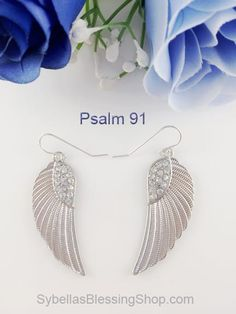 Begins at $10 USD Psalm 91 Angel Wing Earrings Lg. Our Psalm 91 Angel Wing Earrings Lg are a gorgeous white silver with rhinestone bling, making them stand out like the powerful scripture they are based on! These go wonderfully with our Psalm 91 matching necklace and bracelet. Other scripture products at https://www.sybellasblessingshop.com/product/psalm-91-angel-wing-earrings-lg/