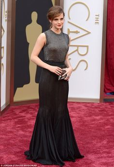 Flying the flag: Emma Watson arrives at the Oscars in a stunning floor-length gown...