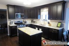 Beautiful dark kitchen featuring Belleair Maple Espresso cabinets on the perimeter and island. Dark Stained Cabinets, Paint Cabinets White, Painting Cabinets, Cabinet Door Styles, Cabinet Doors, L Shaped Kitchen, Kitchen And Bath, Discount Cabinets, Espresso Cabinets