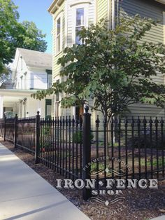 Worried about installing an iron fence down a hill or slope?  So long as its not too severe, you can stair-step the fence panels to 'walk' the fence down your grade.  And it looks great to boot!