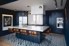 This apartment in Singapore is full of bold blue and black
