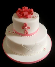 Pink and white bow christening cake