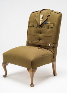 We have taken a lovely vintage hall chair and reupholstered it in an original British Army uniform keeping as much of the uniform as possible