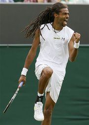 I've never heard of Dustin Brown, the German player who upset Lleyton Hewitt at Wimbledon 2013, but I love the dreadlocks.