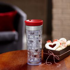 I am a sucker for seasonal mugs and drink-ware.  I picked up this seasonal Starbucks® Valentine's Tumbler, 12 fl oz., today.  The awesome thing is that there are color changing hearts on the tumbler that change color when you add your favorite hot beverage.  Happiness for only $10.95 at my local Starbucks.