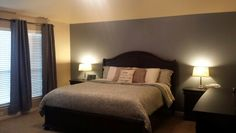 """Accent wall is """"Storm Cloud"""" by Sherwin Williams, main walls are """"Nomadic Desert""""."""