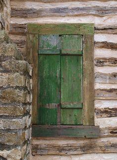 green shuttered window