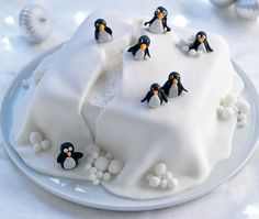 Iced cake with iceberg detailing and black and white penguins sitting on top(Winter Cake Ideas) Christmas Cake Designs, Christmas Cake Decorations, Holiday Cakes, Christmas Desserts, Christmas Treats, Christmas Cakes, Xmas Cakes, Christmas Christmas, Christmas Colors