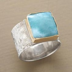 BARAHONA RING ~ Larimar, a rare volcanic gem, is found on only one island in all the world; its variegated hue reflects its Caribbean origins. Handcrafted exclusive in sterling silver; 14kt gold bezel.