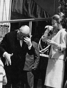 Director Alfred Hitchcock and Tippi Hedren on the set of The Birds, 1963.