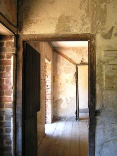 Aiken-Rhett House first floor in slave quarters....Very disturbing to touch the clothing pegs, knowing they were used and touched daily by slaves.
