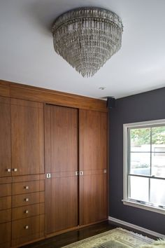 Cabinets, dark walls, decadent chandelier...I don't know where to start