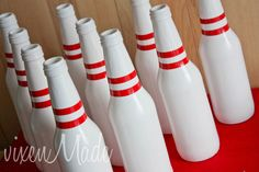 For my brother!!!  Bowling Centerpiece Spray paint soda bottles white, add red elecrical tape stripes. Too cute!
