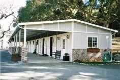 Gray shedrow horse barn
