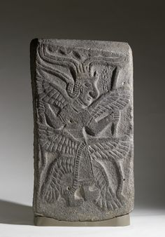"Slab with Six-Winged Goddess - This goddess has been associated with the biblical seraph because of Isaiah's description of these celestial beings: ""each had six wings: with two they covered their faces, and with two they covered their feet, and with two they flew."" ; 10th-9th century BC (Aramaic)"