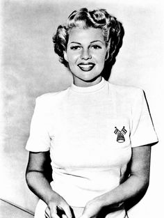 """Rita Hayworth, 1947. This was taken during Rita's brief blonde period while filming then-husband Orson Welles' classic film noir """"The Lady from Shanghai"""". Harry Cohn, Rita's boss at Columbia Studios, absolutely hated Rita's short blonde hairdo, barking at Welles: """"You've ruined her!"""" Rita, feeling liberated from her """"Gilda"""" image, absolutely loved her new hairstyle, especially after it angered Cohn so much."""