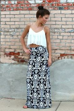 Maxi skirt  crop top. Love the peep of skin... Just enough to keep it classy.