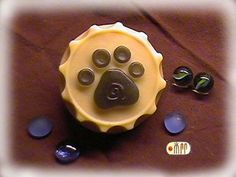 Dog Paw in Bottle Cap Silicone Soap Mold ( Soap Republic ). $12.00, via Etsy.