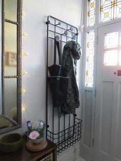 Metal coat rack, hallway storage, hallway hanging space.