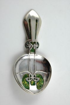 Silver and enamel caddy spoon by Archibald Knox for Liberty & Co. 1903.