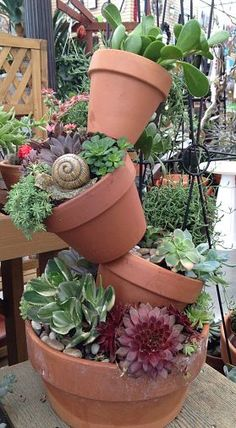 like the stacked idea with succulents since they need very little moisture.Tree of Terracotta Pots filled with Hens and Chicks, Sedum & other Succulents Succulents In Containers, Cacti And Succulents, Planting Succulents, Planting Flowers, Succulent Pots, Potted Plants, Garden Junk, Garden Pots, Herb Garden